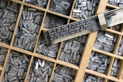 old time lead type and composing stick